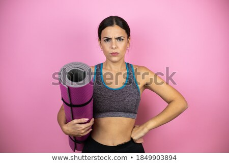 Serious sports lady posing in gym with arms crossed Stock photo © deandrobot