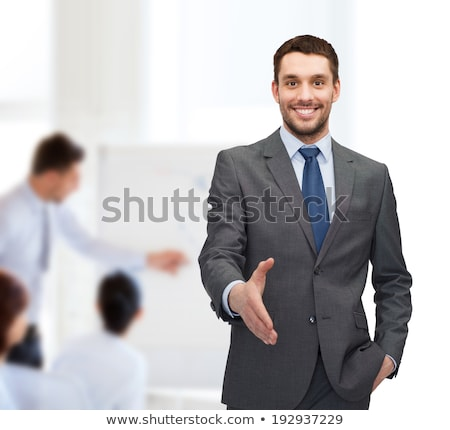 Stock photo: Young smiling businessman ready to handshake