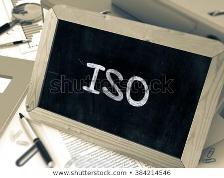 ISO Handwritten on Chalkboard. Stock photo © tashatuvango