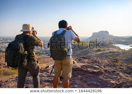 Hindu nature photographer with digital camera. Stock photo © RAStudio