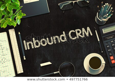 inbound crm handwritten on black chalkboard 3d rendering stock photo © tashatuvango