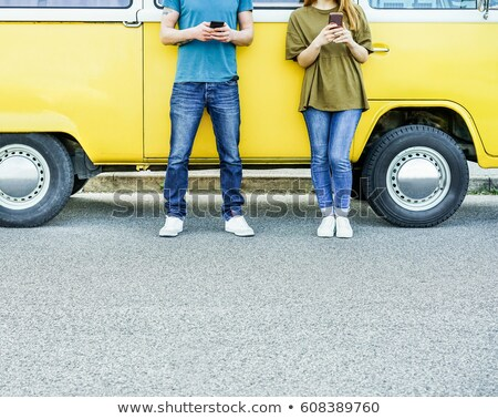 man using smartphone in minivan Stock photo © LightFieldStudios