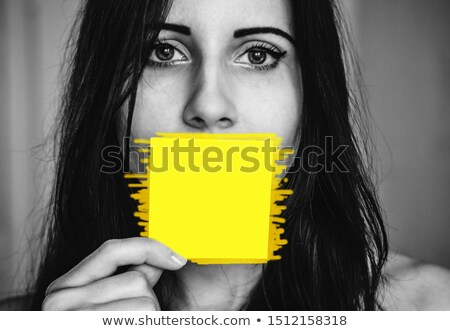 Woman near blanks with text about feminism. Stock photo © deandrobot