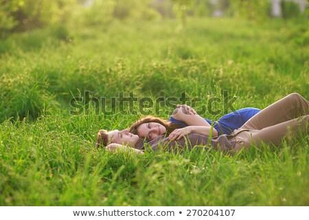 Pareja · mentir · hierba · verde · parque · aire · libre · tiro - foto stock © Massonforstock