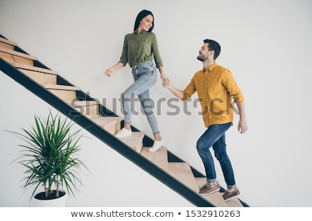 happy young casual woman walking and welcoming  Stock photo © feedough
