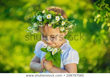 Smiling girl with a wreath of twigs Stock photo © artjazz