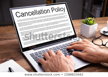 A Cancellation agreement with a pen on a desk Stock photo © Zerbor