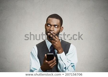 Сток-фото: портрет · путать · человека · мобильного · телефона · недоуменный