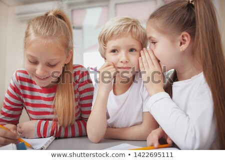 Girls whispering in class Stock photo © IS2
