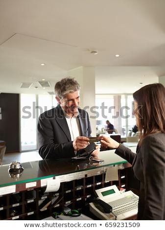 Twee zakenlieden hotel receptie business zakenman Stockfoto © IS2