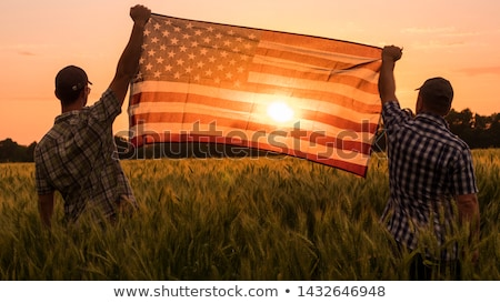 man with american flags
