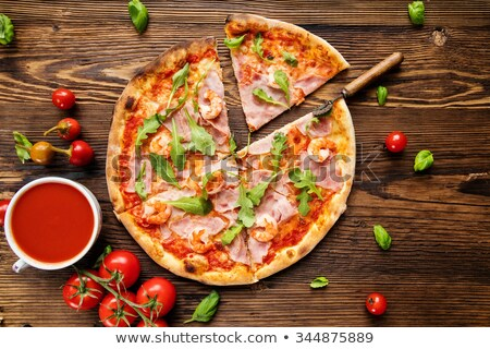 delicious italian pizza served on wooden table shot from above stock photo © dash