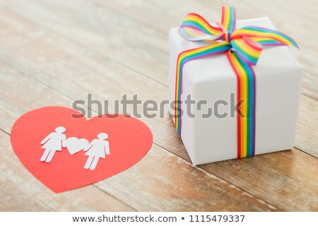 gift with gay awareness ribbon and woman pictogram Stock photo © dolgachov