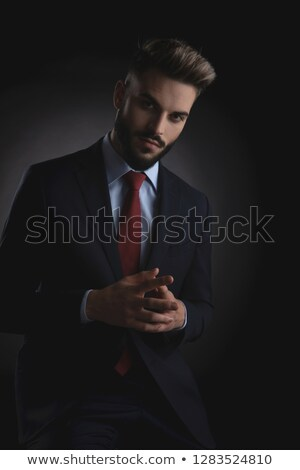 portrait of handsome businessman in navy suit praying Stock photo © feedough