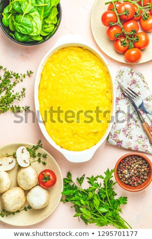 Loaded gratin, julienne or casserole in white ceramic dish Stock photo © artsvitlyna