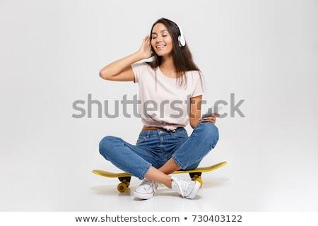friends with skateboards over white background stock photo © dolgachov