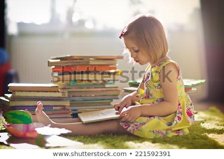 Closeup portrait of a cute, little girl reading a book Stock photo © konradbak