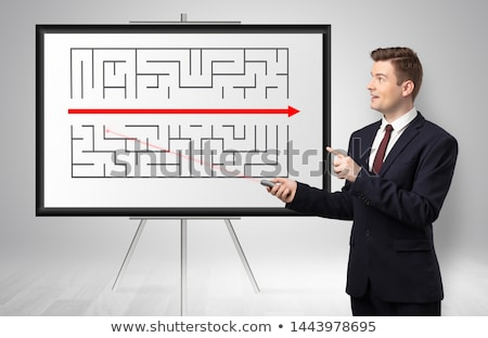 Businessman presenting potential exit from a labyrinth Stock photo © ra2studio
