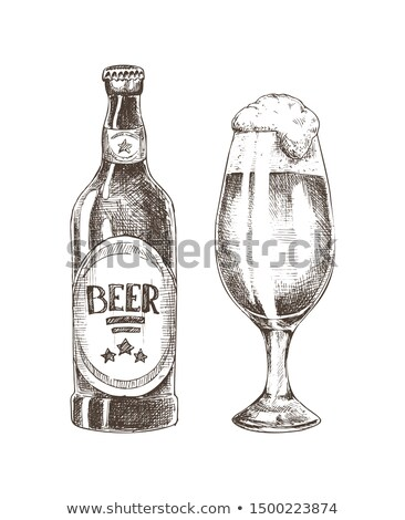 Foamy Beer in Glassy Goblet and Closed Ale Bottle Stock photo © robuart