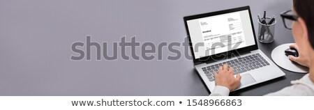 Zakenvrouw Bill computer houten bureau Stockfoto © AndreyPopov