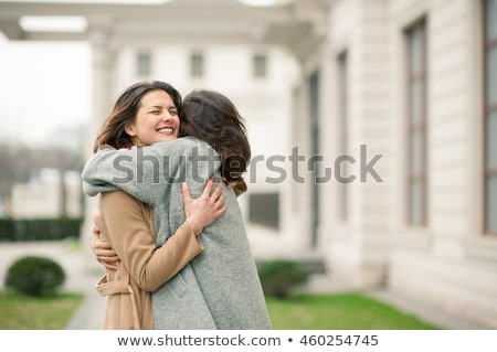 pretty young happy women friends walking outdoors stock photo © deandrobot
