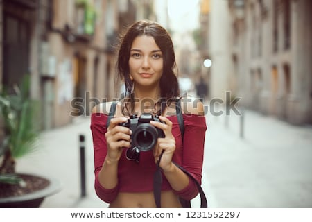 mixed race female photographer with dslr camera stock photo © darrinhenry
