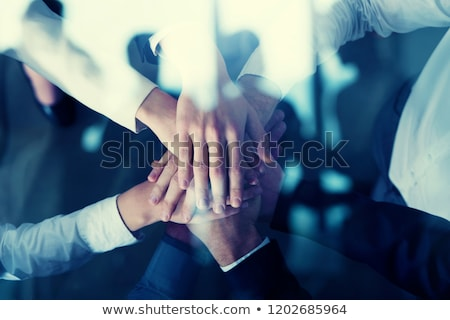 business people putting their hands together concept of startup integration teamwork and partners stock photo © alphaspirit