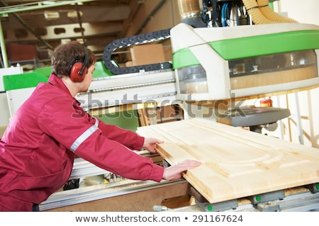 Carpenter worker operating wood cutting machine. CNC woodworking Stock photo © cookelma