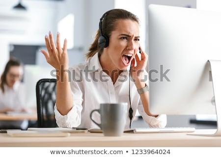 Agresszív elégedetlen üzletasszony iroda callcenter dolgozik Stock fotó © deandrobot