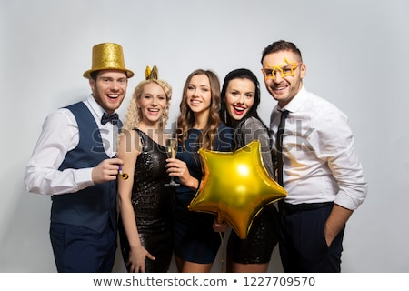 Stock photo: happy friends with golden party props posing