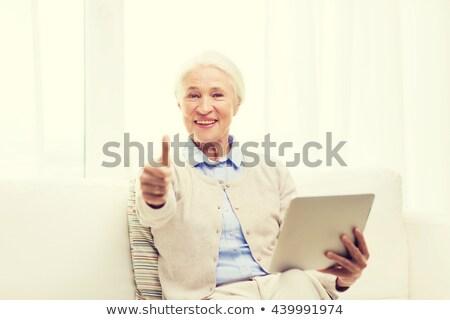 Senior donna tecnologia Foto d'archivio © dolgachov