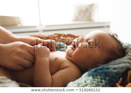 Beşik uyku bebek anne bakıyor ahşap Stok fotoğraf © robuart