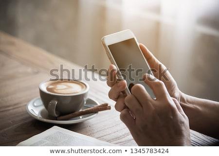cupped senior man hands on table Stock photo © dolgachov