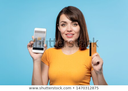 Happy young buyer and online shop client with credit card showing you promo Stock photo © pressmaster