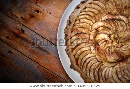 Traditional french apple tart over brown planks Stock photo © tilo