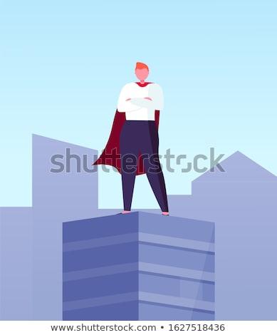 Leader in Superhero Cloak Skyscraper Top in City Stock photo © robuart