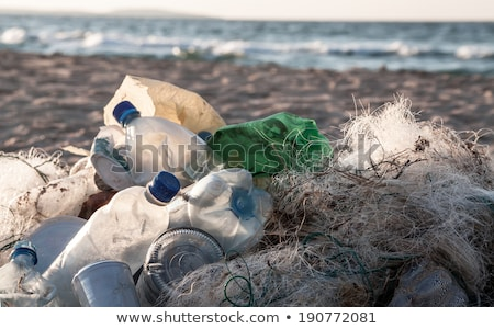 Beach pollution. Plastic bottles and other trash on sea beach Stock photo © galitskaya
