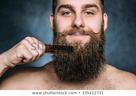 combing beard and mustache Stock photo © Olena