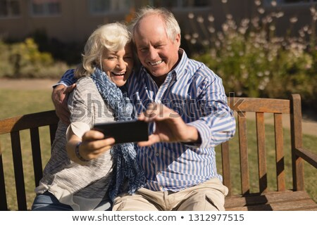 Front view of active senior Caucasian couple taking selfie with mobile phone in the park Stock photo © wavebreak_media