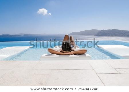 Mutlu kadın yüzme havuzu başvurmak insanlar Stok fotoğraf © dolgachov