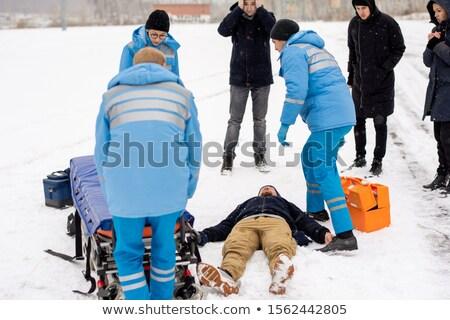 Jonge uniform voortvarend bewusteloos man Stockfoto © pressmaster