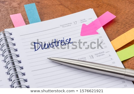 Daily planner with the entry Business Trip - Dienstreise (German Stock photo © Zerbor