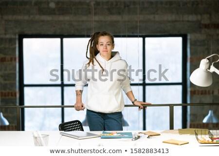 Güzel genç tasarımcı bakıyor ayakta işyeri Stok fotoğraf © pressmaster