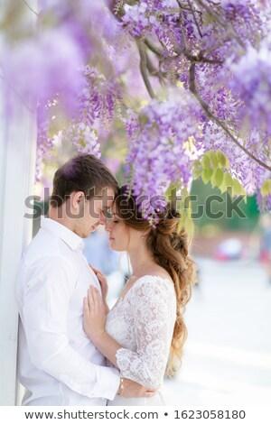 Bridegroom man and springtime woman hug each other in the Park Stock photo © ElenaBatkova