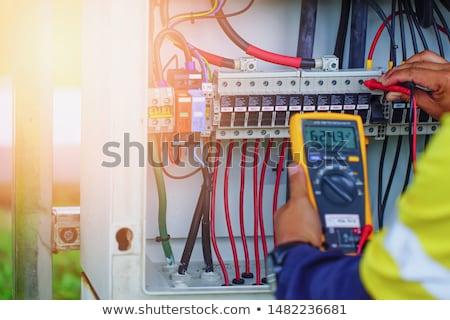 Elektryk napięcie mężczyzna gniazdo domu tle Zdjęcia stock © AndreyPopov