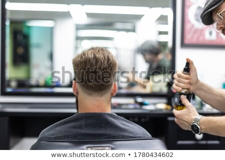 Barbeiro spray masculino cabelo compras Foto stock © dolgachov