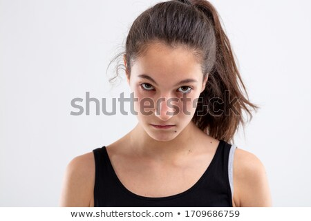 Sulky angry young woman glowering at camera Stock photo © Giulio_Fornasar