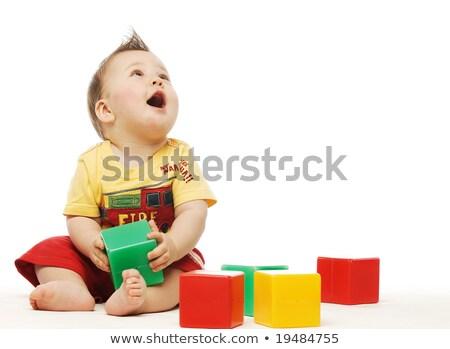 bebê · amarelo · camisas · jogar · brinquedos · edifício - foto stock © dacasdo