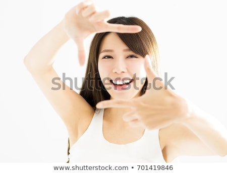Young woman is focused view in the viewfinder gestures  Stock photo © ilolab