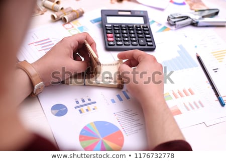 Foto stock: Business Chart With Calculator And Indian Money